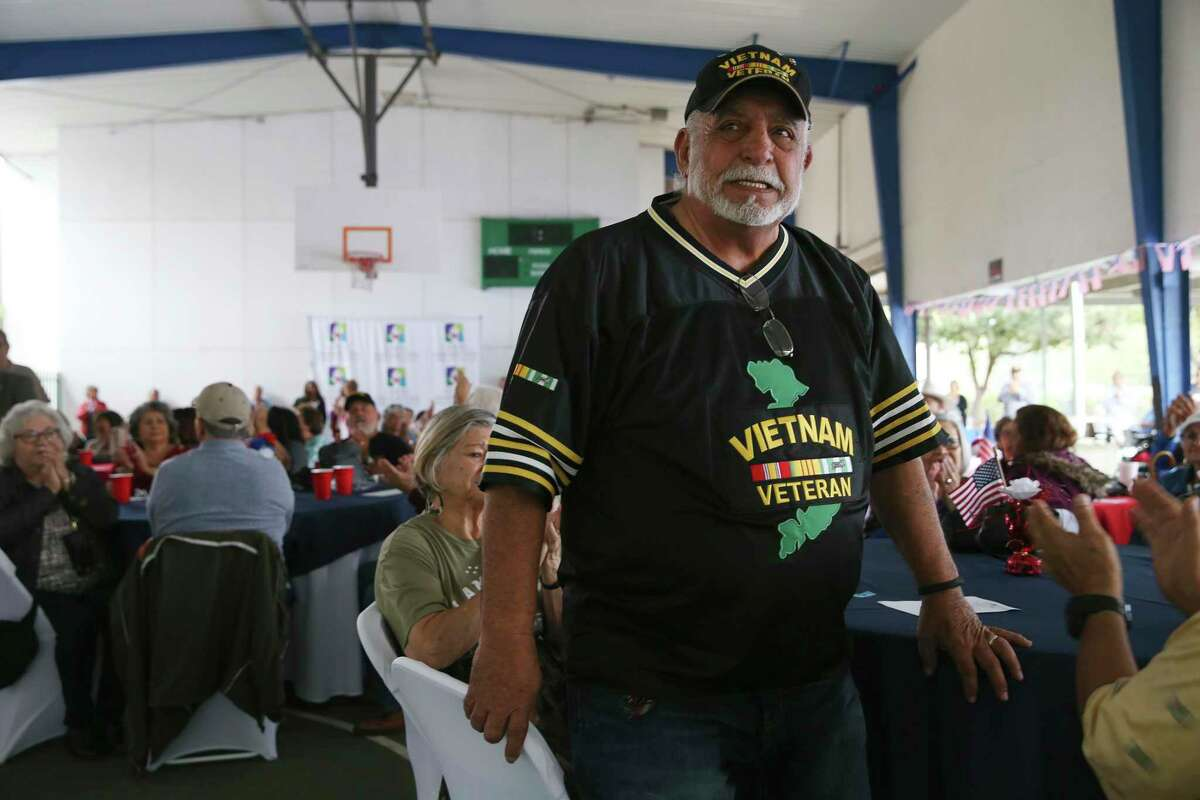 Vietnam veteran Reuben Rendon, 82, stands up as military veterans are honored during a ceremony at the Good Samaritan Center on the West Side on Thursday.