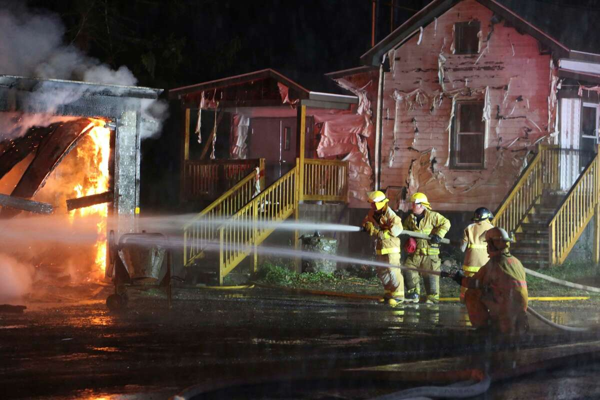 Firefighters battle a blaze at a garage in the Schoharie County community of North Blenheim