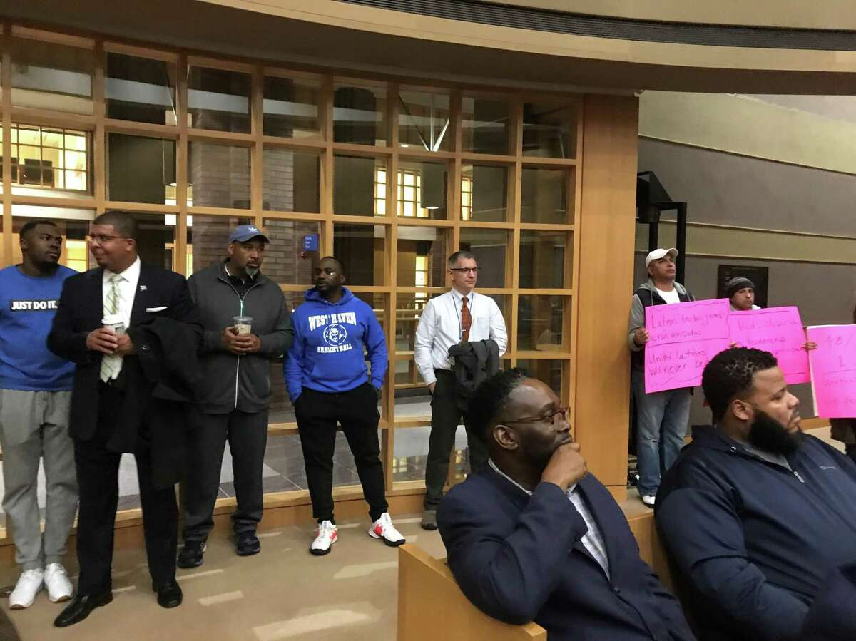Supporters and critics of Board of Education appointee Larry Conaway at a Nov. 7, 2019 Board of Alders meeting.