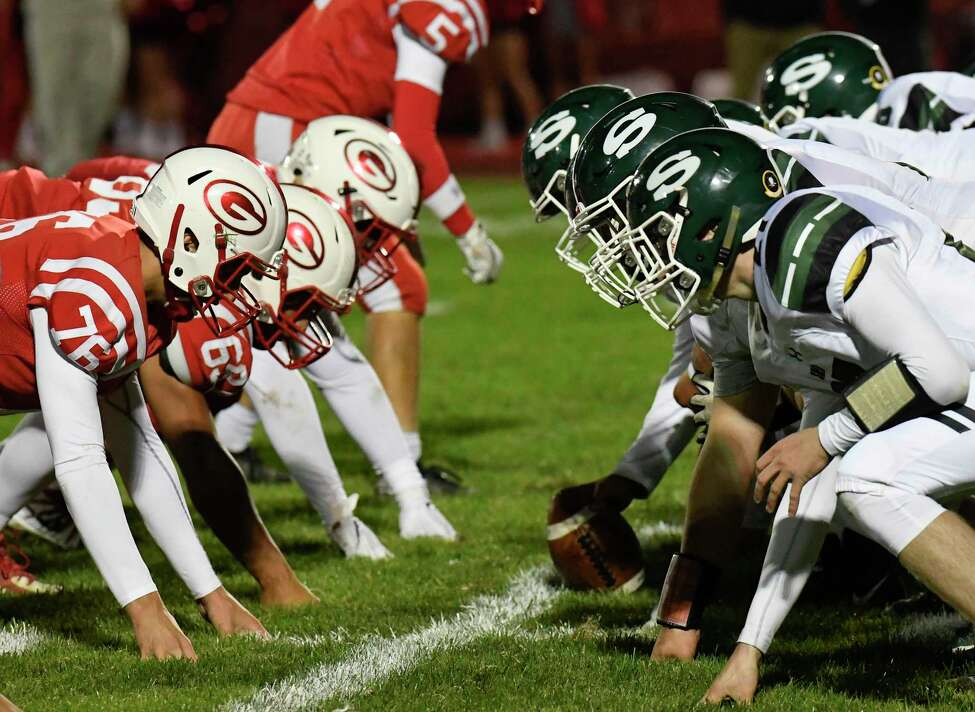 Guilderland's defense ,left, lines up against Shenendehowa's offense during a Section II Class AA high school football game in Guilderland, N.Y., Friday, Oct. 4, 2019. (Hans Pennink / Special to the Times Union)