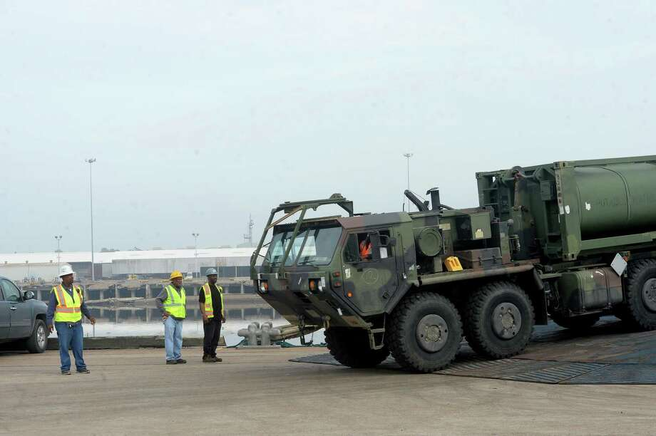 Military equipment is unloaded at the Port of Beaumont on the first day of a cargo unload run by the 842nd Transportation Battalion . The 2,500 pieces, which arrived from Europe will be loaded onto rail cars for transport back to Fort Riley in Kansas. It is the first of three military cargo operations planned to take place at the port. Photo taken Thursday, November 7, 2019 Kim Brent/The Enterprise Photo: Kim Brent / The Enterprise / BEN