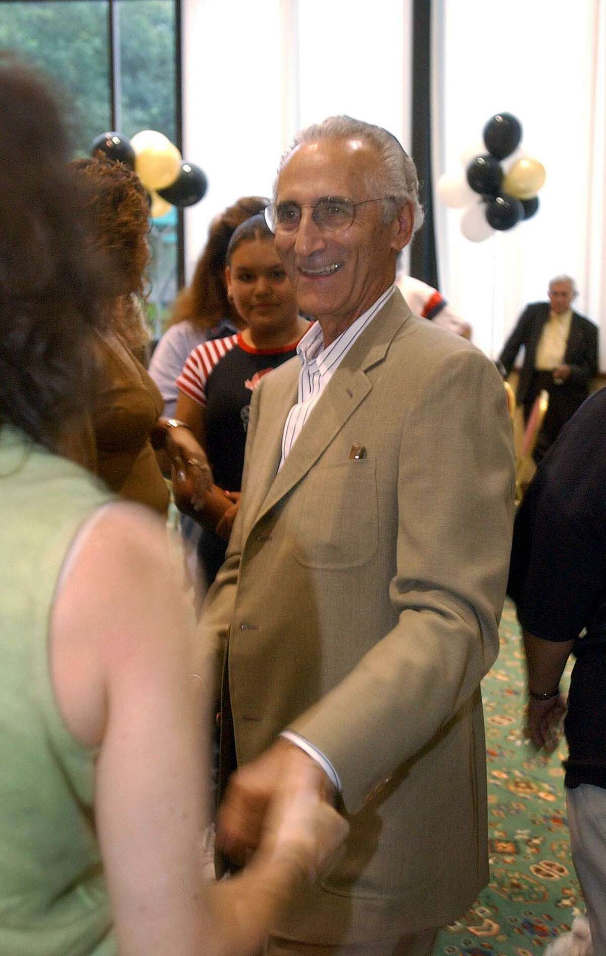 METRO - San Antonio City Council Candidate Bert Cecconi greets supporters at the Marriott, Loop 410 and Interstate 10, during a gathering to await results of City Council District 8 runoff elections on Tuesday, May 27, 2003. BILLY CALZADA / STAFF
