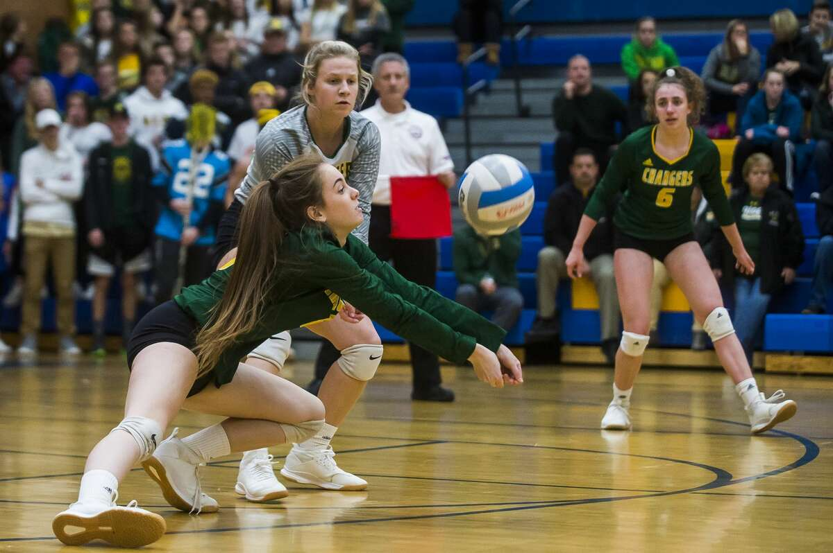 Dow's Anna Schalk bumps the ball during the Chargers' district final against Mt. Pleasant Thursday, Nov. 7, 2019 at Midland High School. (Katy Kildee/kkildee@mdn.net)