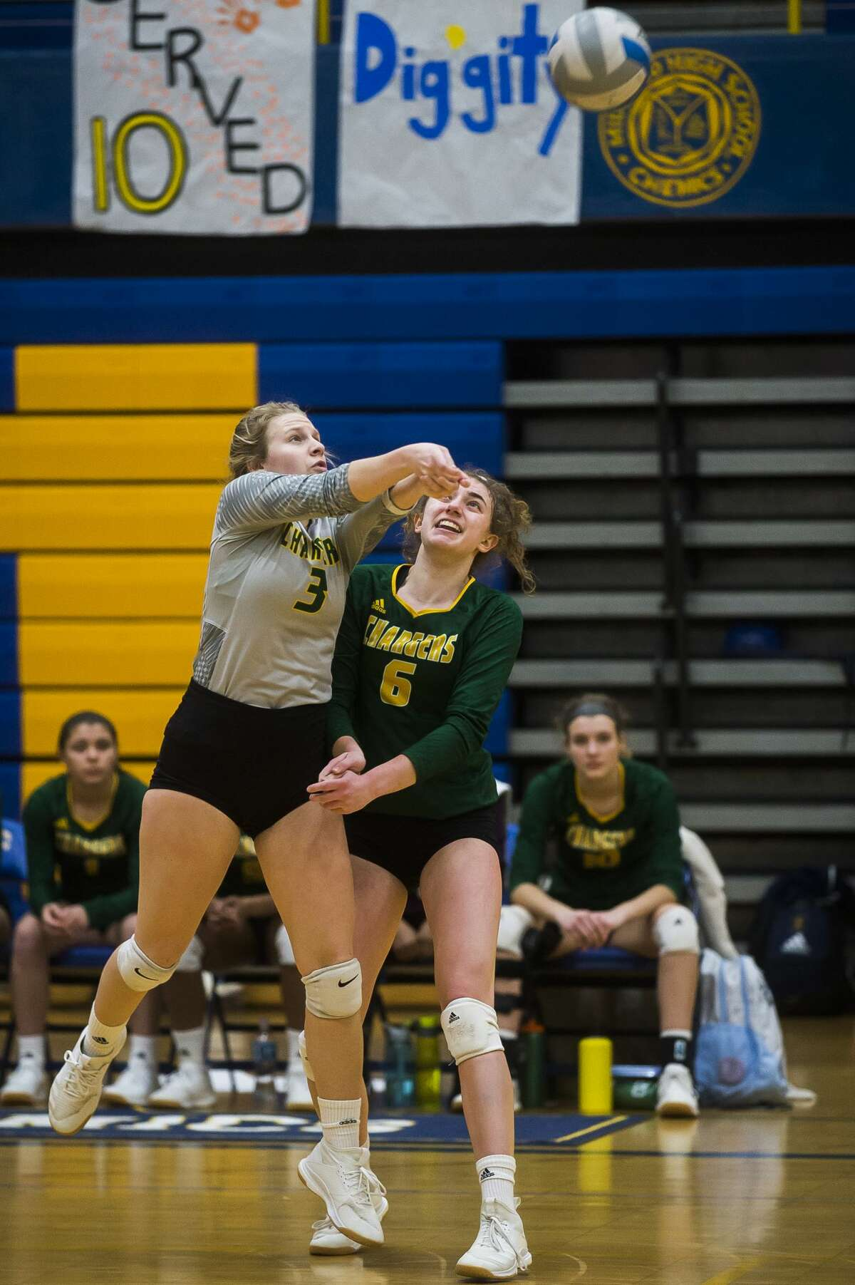 Dow's Jenna Somers, left, and Francesca Queary, right, both move to bump the ball during the Chargers' district final against Mt. Pleasant Thursday, Nov. 7, 2019 at Midland High School. (Katy Kildee/kkildee@mdn.net)