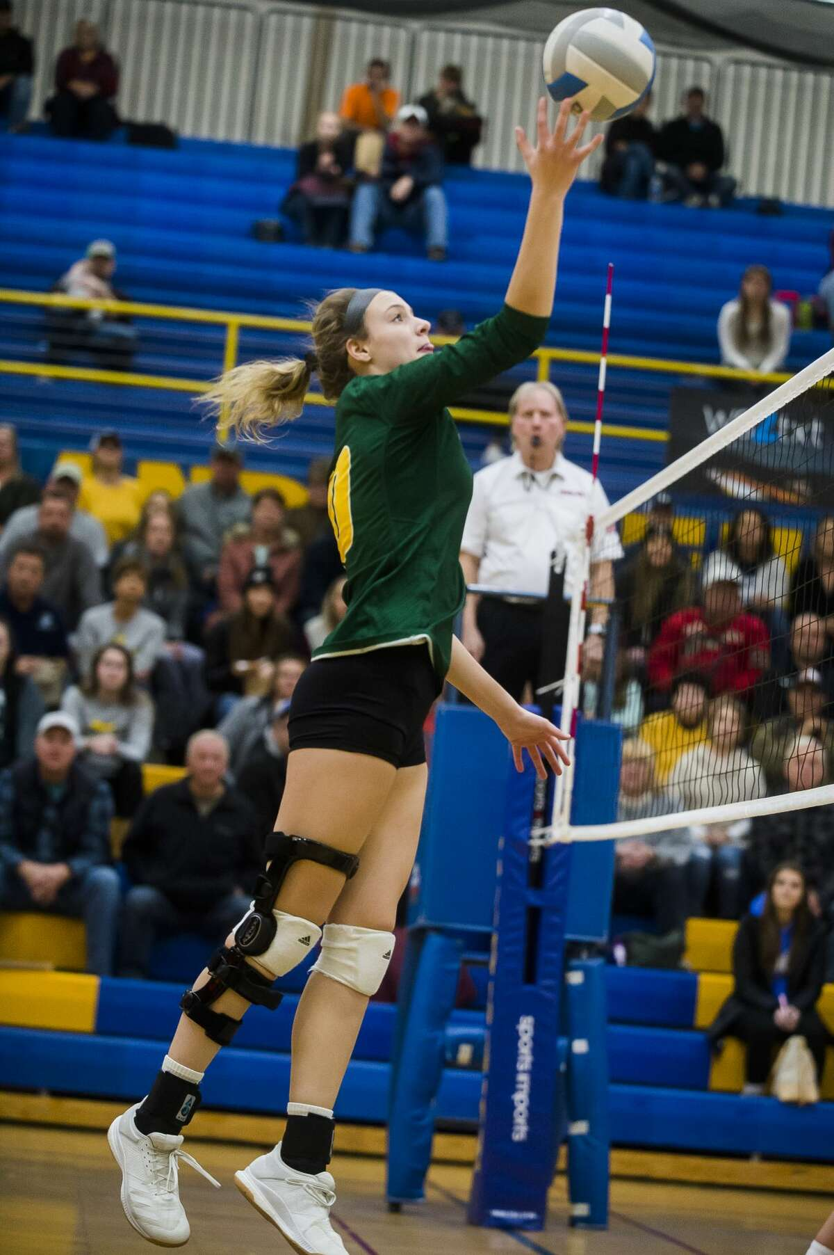Dow's Haley Jaster tips the ball during the Chargers' district final against Mt. Pleasant Thursday, Nov. 7, 2019 at Midland High School. (Katy Kildee/kkildee@mdn.net)