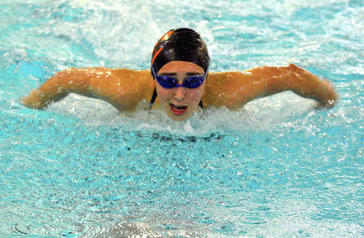 Edwardsville's Maddie Milburn swims in the 100-yard butterfly.