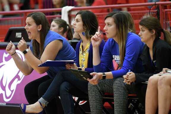 Friendswood head volleyball coach Sarah Paulk (left) used some inspirational words in the first set to help her team rally past Richmond Foster Thursday night in the Class 5A playoffs.