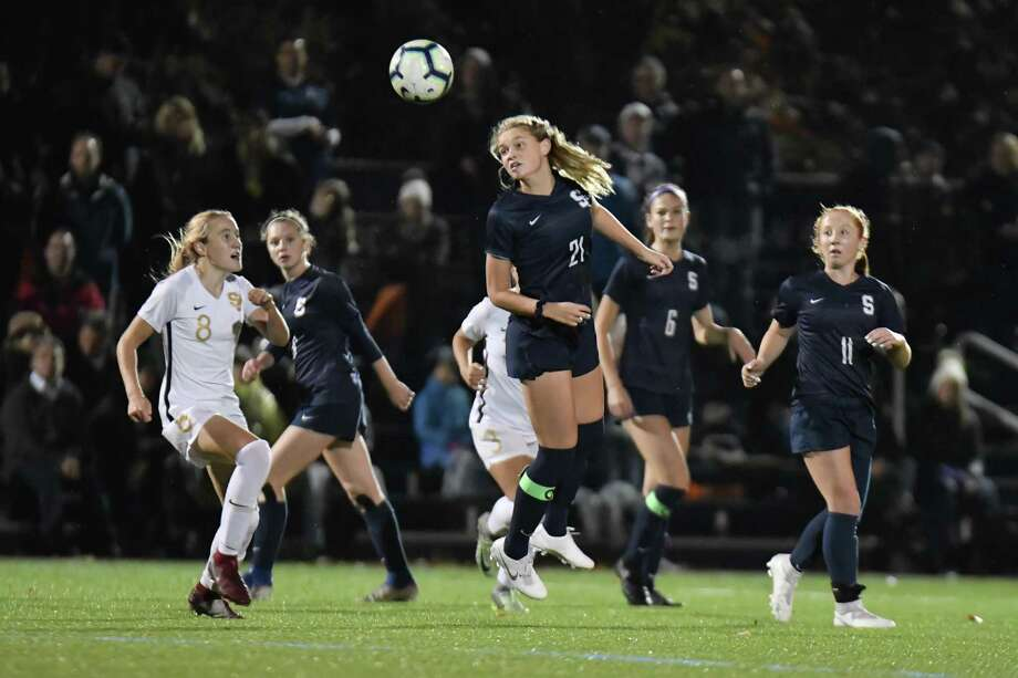 Reese Sutter (21) of the Staples Wreckers heads a ball forward during the FCIAC Girls Soccer Championship against the St. Joseph Cadets on Thursday at Wilton High School in Wilton. Wilton won 1-0. Photo: Gregory Vasil / For Hearst Connecticut Media / Connecticut Post Freelance