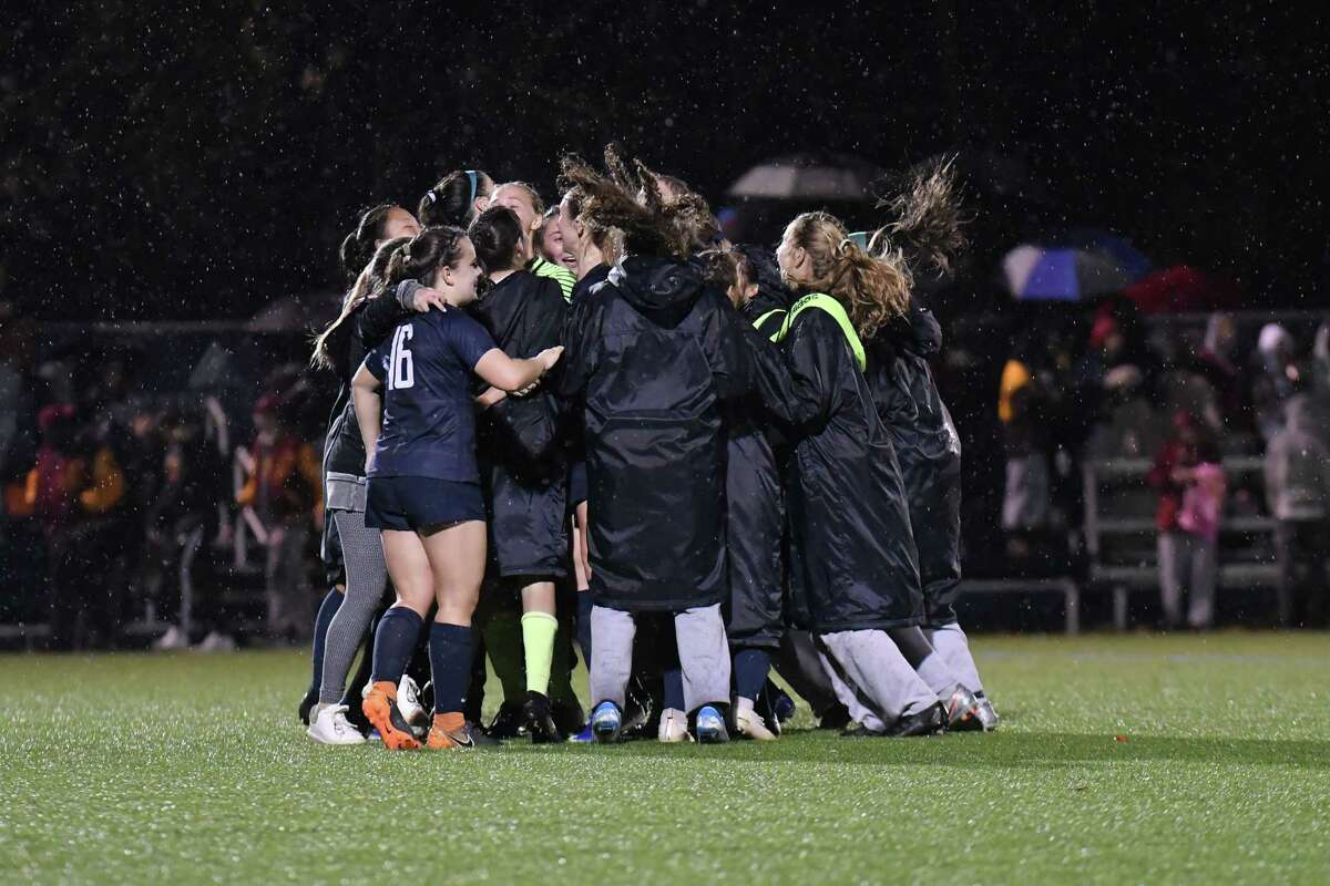 Staples players celebrate after winning the FCIAC girls soccer championship over St. Joseph on Nov. 7 in Wilton.