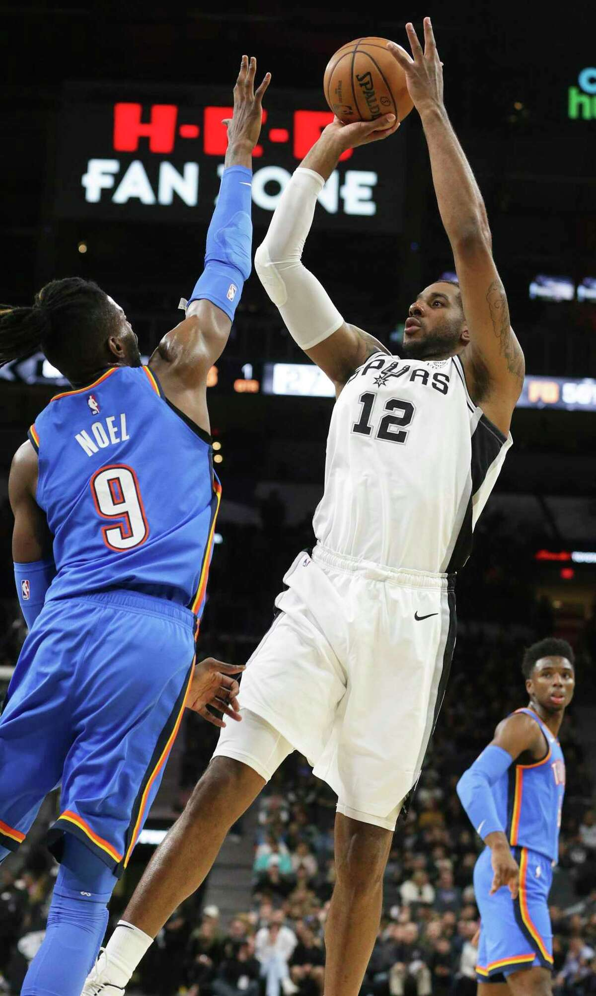 LaMarcus Aldridge shoots over Oklahoma City's Nerlens Noel in the first half. Aldridge went 19 of 23 from the field in his best performance of the season.