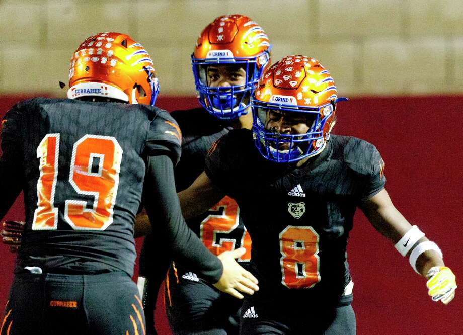 In this file photo, Grand Oaks running back Micah Cooper (8) reacts with quarterback Hudson Hamilton (19) after running for a 34-yard touchdown during the first quarter of a non-district high school football game at Woodforest Bank Stadium, Thursday, Oct. 31, 2019, in Shenandoah. Photo: Jason Fochtman, Houston Chronicle / Staff Photographer / Houston Chronicle