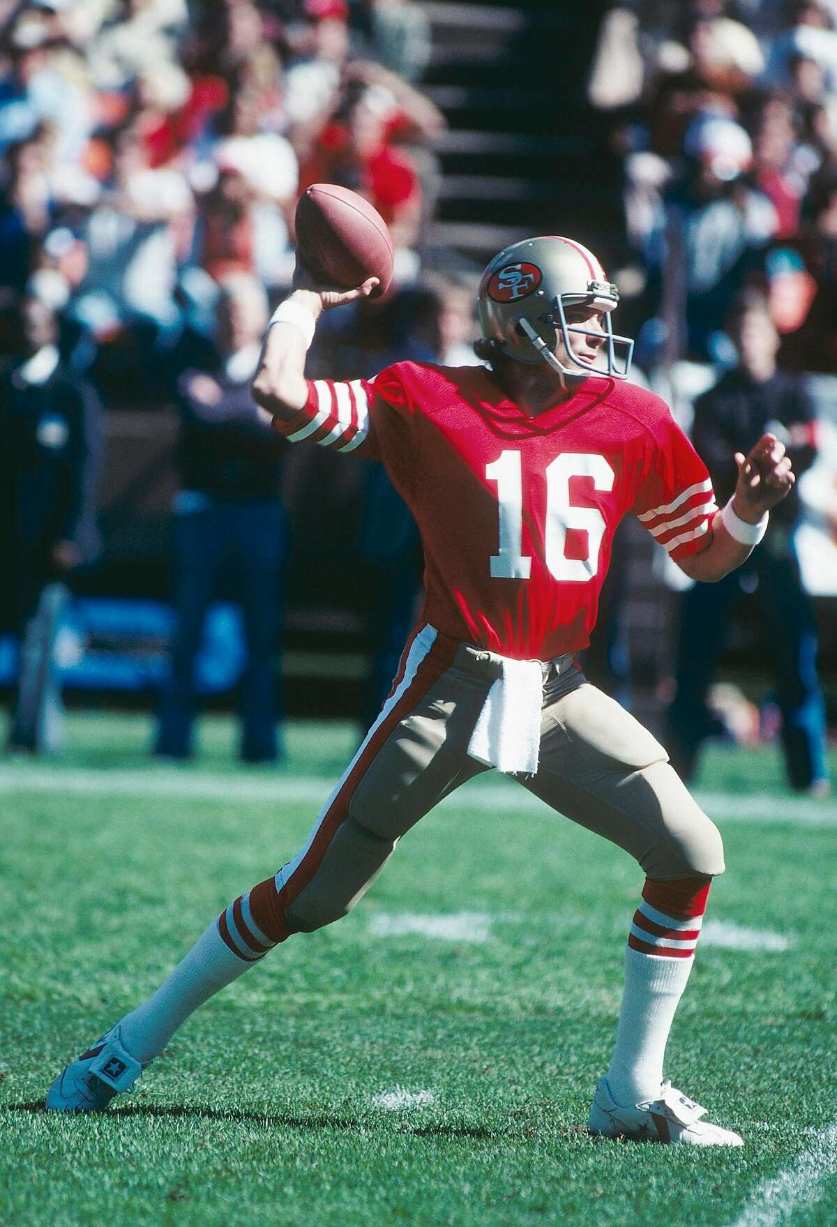 SAN FRANCISCO - OCTOBER 1981: Joe Montana of the San Francisco Forty-Niners passes at Candlestick Park in San Francisco, California.