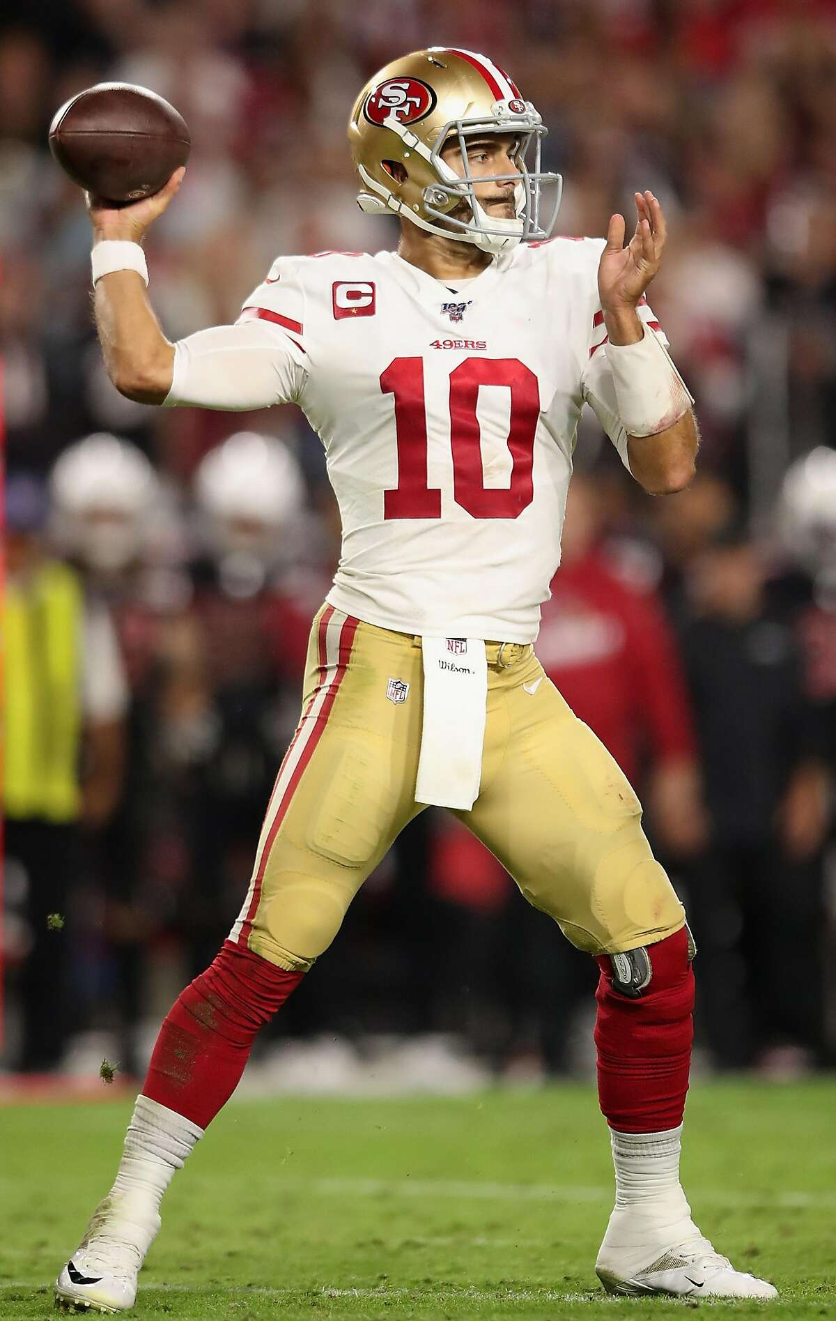 GLENDALE, ARIZONA - OCTOBER 31: Quarterback Jimmy Garoppolo #10 of the San Francisco 49ers throws a pass during the second half of the NFL game against the Arizona Cardinals at State Farm Stadium on October 31, 2019 in Glendale, Arizona. The 49ers defeated the Cardinals 28-25. (Photo by Christian Petersen/Getty Images)