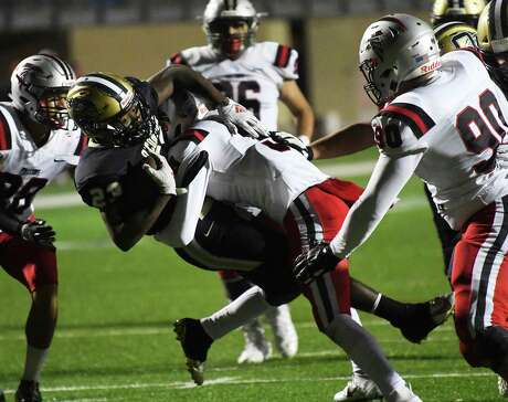 O'Connor running back Zion Taylor is tackled by Stevens defensive back Eli Wilkinson-Alexander. Taylor rushed for three touchdowns, all set up by big defensive plays. Photo: Billy Calzada /Staff Photographer / San Antonio Express-News
