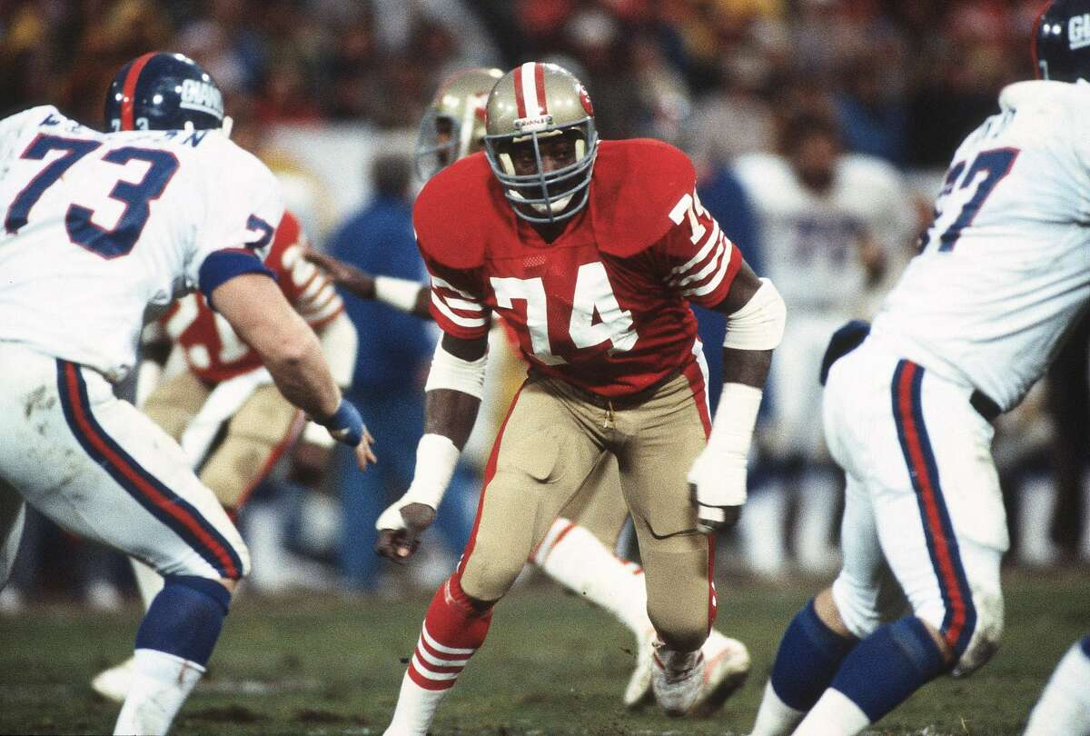 Fred Dean #74 of the San Francisco 49ers in action against the New York Giants during an NFL football game November 29, 1981 at Candlestick Park in San Francisco, California. Dean played for the 49ers from 1981-85.