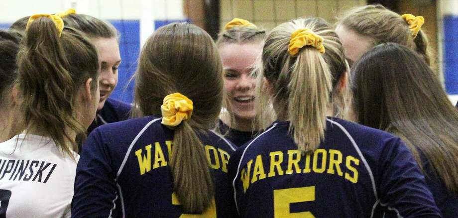 The Ubly varsity volleyball team topped the North Huron Warriors on Thursday and captured their first district title in 10 years. Photo: Mark Birdsall/Huron Daily Tribune