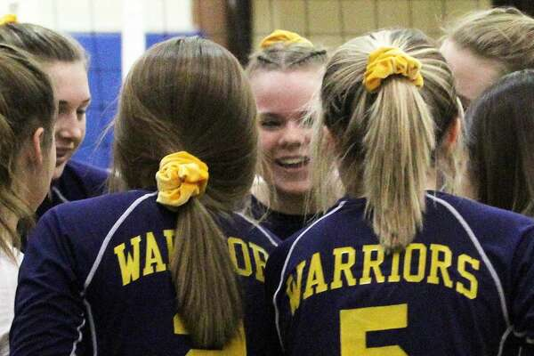 The Ubly varsity volleyball team topped the North Huron Warriors on Thursday and captured their first district title in 10 years.