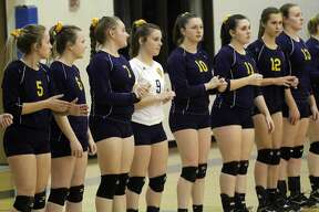 The Ubly varsity volleyball team topped the North Huron Warriors on Thursday and captured their first district title in 10 years. The Ubly varsity volleyball team topped the North Huron Warriors on Thursday and captured their first district title in 10 years.