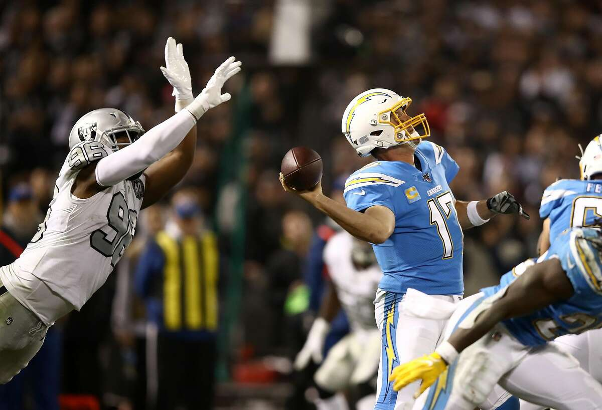 OAKLAND, CALIFORNIA - NOVEMBER 07: Clelin Ferrell #96 of the Oakland Raiders pressures Philip Rivers #17 of the Los Angeles Chargers as Rivers passes the ball at RingCentral Coliseum on November 07, 2019 in Oakland, California. (Photo by Ezra Shaw/Getty Images)