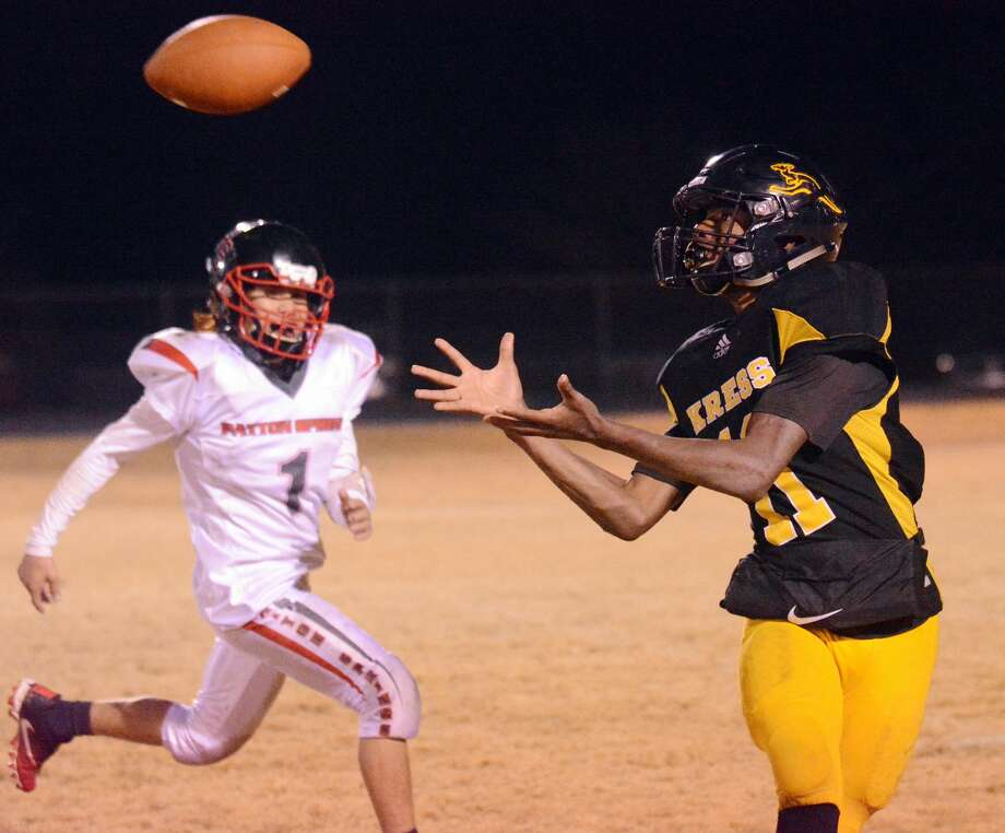 Kress' Ja'qavien Ellis hauls in a 47-yard touchdown off a pass from Cooper Bye during their District 2-1A Division II football game against Afton Patton Springs on Thursday in Kress. Photo: Nathan Giese/Planview Herald