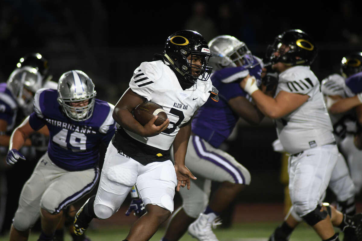 Klein Oak sophomore running back Charles Garrett (3) breaks away from Klein Cain defender Clayton Saxton (49) late in the 4th quarter of their District 15-6A matchup at Klein Memorial Stadium in Spring on Nov. 7, 2019.