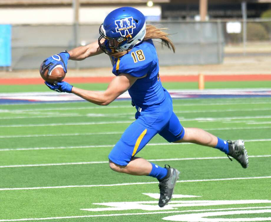 Wayland Baptist receiver Caden Bailey leaps in the air to come up with the catch in a Sooner Athletic Conference football game against Oklahoma Panhandle State last week. Photo: Nathan Giese/Planview Herald