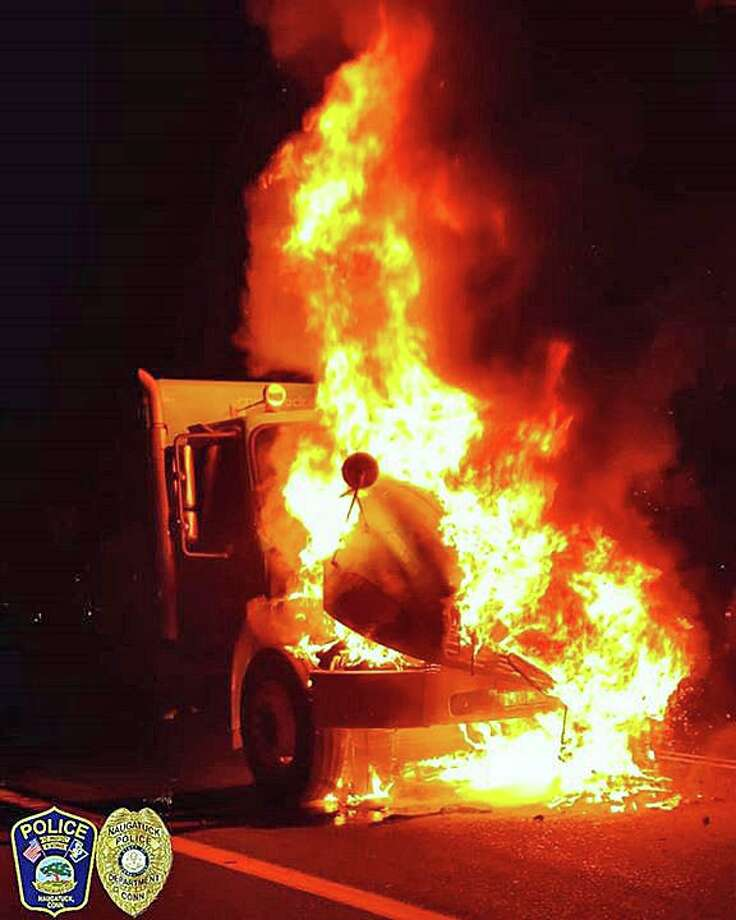 "A driver is lucky to be unharmed after his truck burst into flames on Route 8 in Naugatuck on Thursday, Nov. 7, 2019. ""The operator of the vehicle heard a 'pop' and the check engine light came on. Smoke then began spilling from underneath the hood,"" Naugatuck police said. ""The operator quickly exited and created distance between himself and the vehicle."" Photo: Naugatuck Police Photo"
