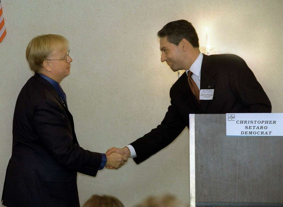 Mark Boughton, left and Chris Setaro, candidates for mayor of Danbury shake hands after a candidates debate sponsored by the Greater Danbury Chamber of Commerce in 2001.