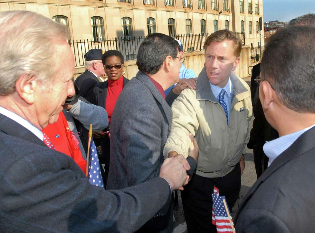 U.S. Sen. Joseph Lieberman, left, and Democratic senate candidate Ned Lamont greet each other at the start of the 2006 Veterans Day Parade in Hartford. Hartford Mayor Eddie Perez is at right.