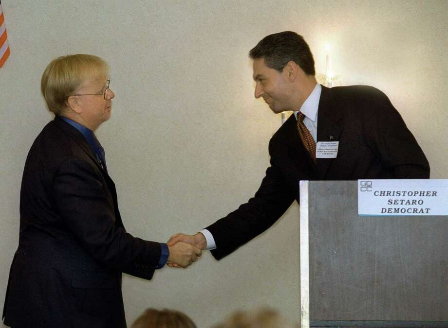 Mark Boughton, left and Chris Setaro, candidates for mayor of Danbury shake hands after a candidates debate sponsored by the Greater Danbury Chamber of Commerce in 2001. Photo: Hearst Connecticut Media File Photo / The News-Times