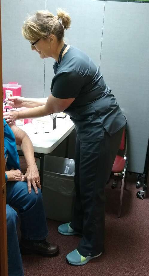 On Friday, a group from the health department spent the day at the senior center dispensing flu shots to seniors. Photo: Photo Provided By Manistee Senior Center
