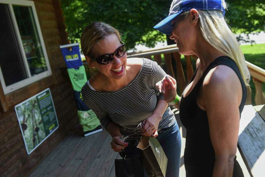 "A matchmaker set up Rebekah Kelley, left, and Noreen Butler on a platonic ""friend date"" at a ropes course in Rockville, Md., in June. Photo: Washington Post Photo By Michael Robinson Chavez / The Washington Post"