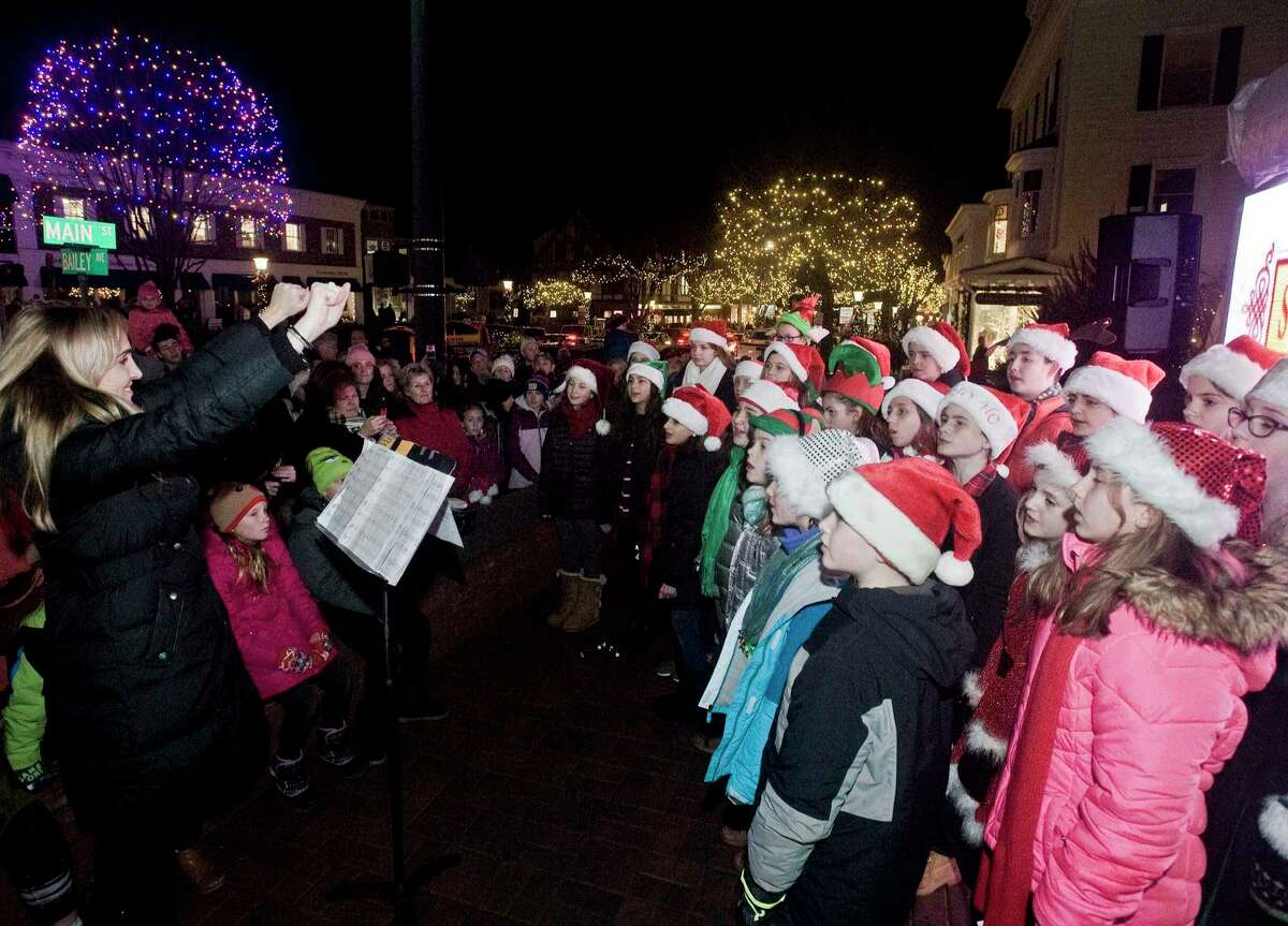 The Glee Club performing on Main Street under the direction of Anya Caravella.