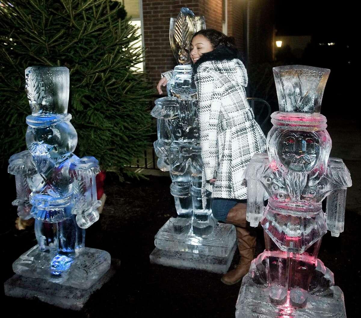 Tatiana Carmona gives an ice sculpture a hug at the Town Hall.