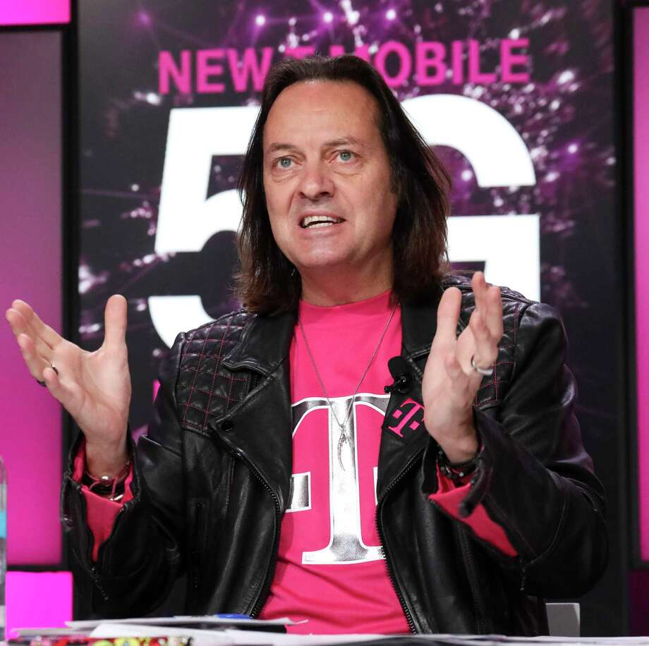 T-Mobile CEO John Legere on Thursday, Nov. 7, 2019, in New York City, during an announcement revealing the company's plan in early December to light up 5G wireless broadband service in more than 5,000 municipalities nationally. Photo: Brian Ach / Associated Press / Copyright 2019 The Associated Press. All rights reserved.