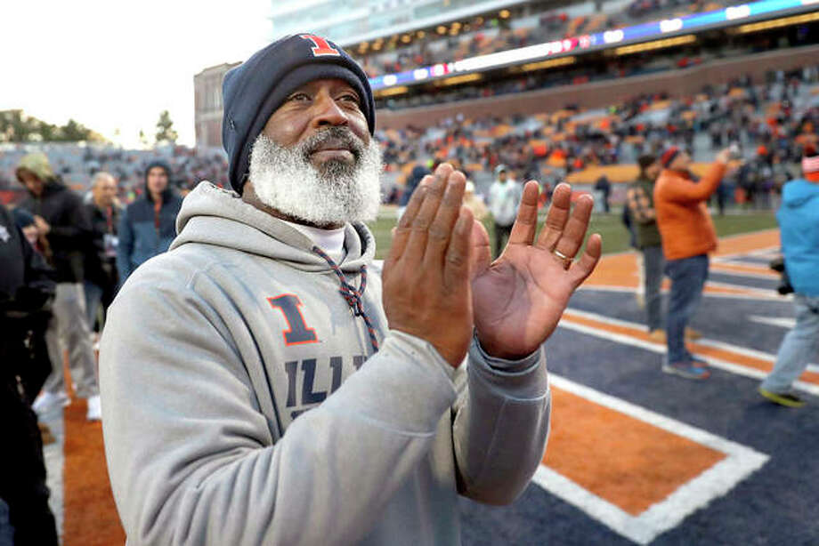 Illinois head coach Lovie Smith applauds after his team's 38-10 win over Rutgers last Saturday in Champaign. The Illini have won three straight games and play at Michigan State Saturday. A win would give Illinois bowl-game eligibility. Photo: AP Photo