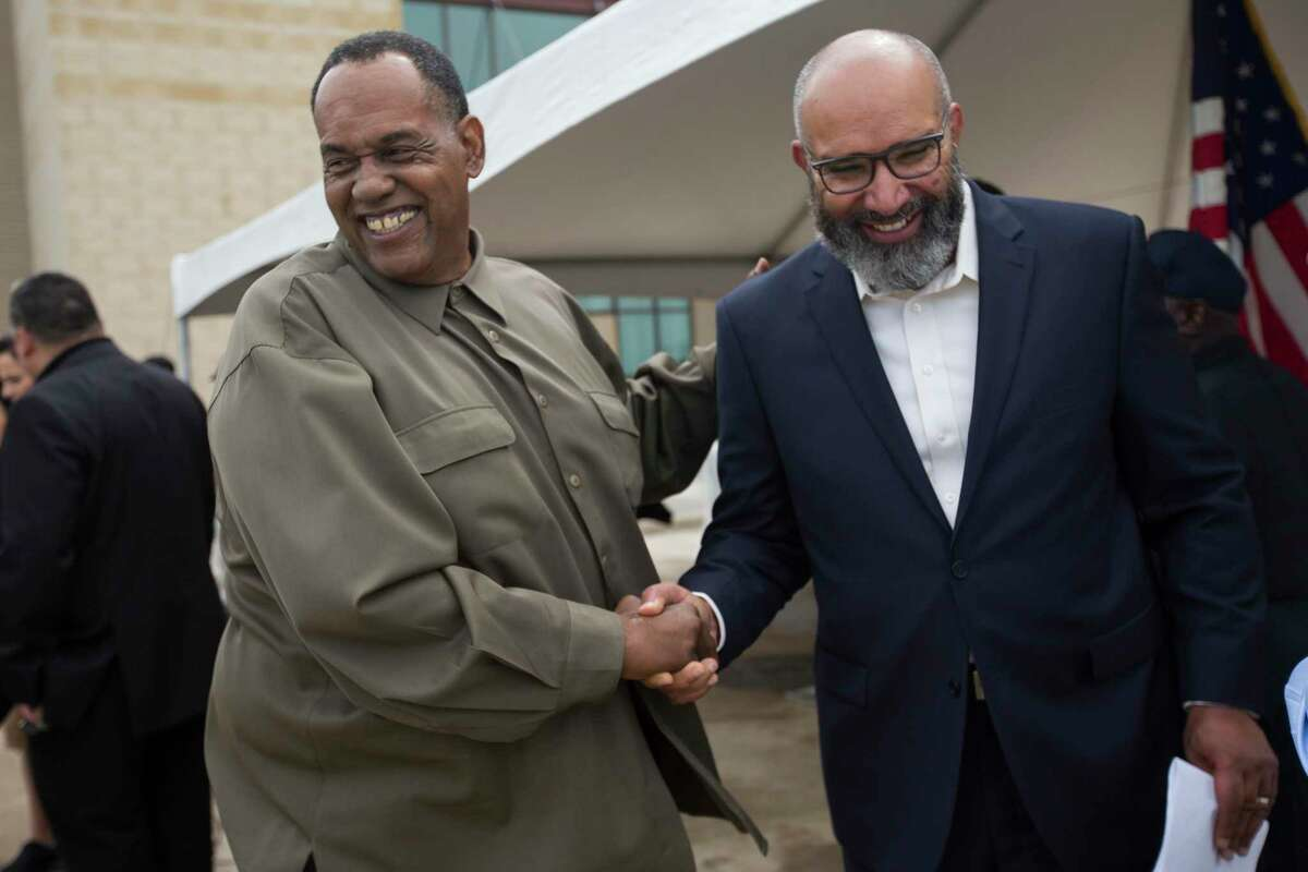 Activist Reginald Moore, from left, and FBISD Superintendent Charles E. Dupre shake hands following a presser celebrating progress on the Sugar Land 95 Memorial Project in Sugar Land, Monday, June 17, 2019. Gov. Abbott signed a bill that would allow Fort Bend County to operate and maintain the cemetery where 95 African American remains were found last year.