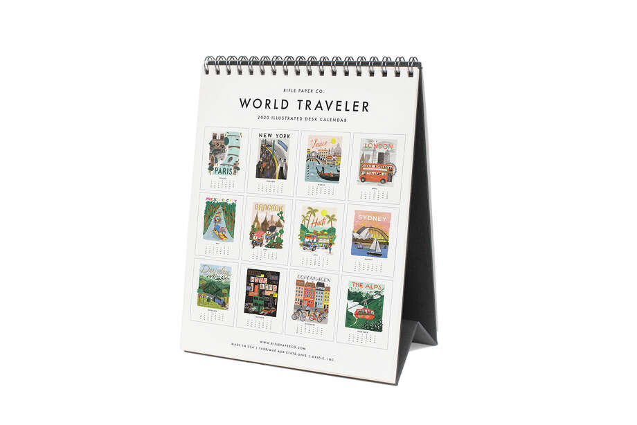 Rifle Paper Co.'s World Traveler 2020 Desk Calendar ($16, riflepaperco.com) features illustrations of wanderlust-worthy locations such as Copenhagen and Mexico City. It comes with a stand and is spiral-bound for easy flipping at your desk. Photo: Rifle Paper Co. Handout Photo / Handout