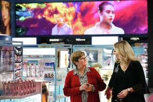 Josie Conner, left, talks with Sonia Lujan, cosmetics and beauty lead, at H-E-B's Plus store at Evans Rd.