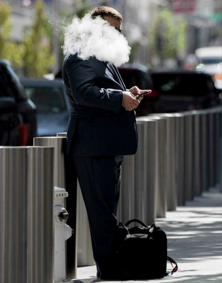 A man smokes an e-cigarette outside of the Transbay Transit Center in San Francisco. Photo: File Photo / ONLINE_YES