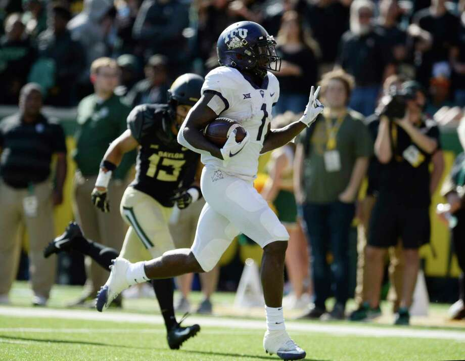 FILE - In this Nov. 17, 2018, file photo, TCU wide receiver Jalen Reagor scores past Baylor cornerback Raleigh Texada in the second half of an NCAA college football game, in Waco, Texas.  (Ernesto Garcia/Waco Tribune-Herald via AP, File) Photo: Ernesto Garcia, Associated Press / South Bend Tribune