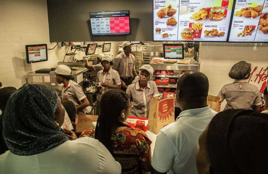 Staff members attend to customers in the new KFC location in Dakar, Senegal, on Oct. 24. Photo: Photo For The Washington Post By Yagazie Emezi / For The Washington Post