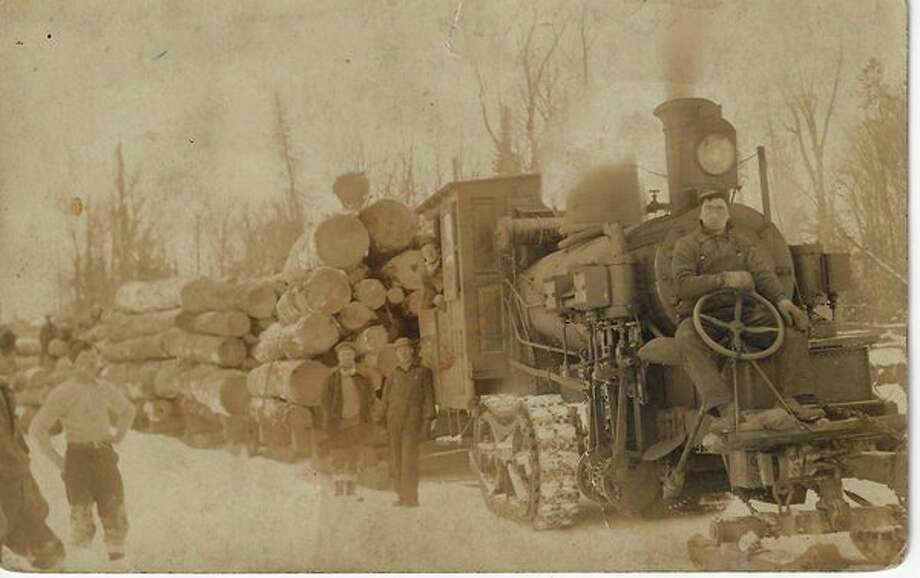 "A machine called a ""steam hauler"" was widely used in lumbering to replace teams in hauling logs from the woods. Even today there is a road named Steam Hauler Road north of Honor. (Courtesy Photo/Benzie Area Historical Society)"