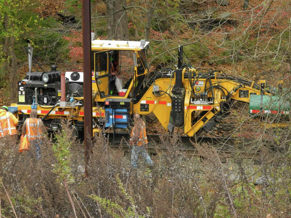 Rail workers replace railroad ties along the Danbury branch line in Wilton, Conn., on Nov. 7.