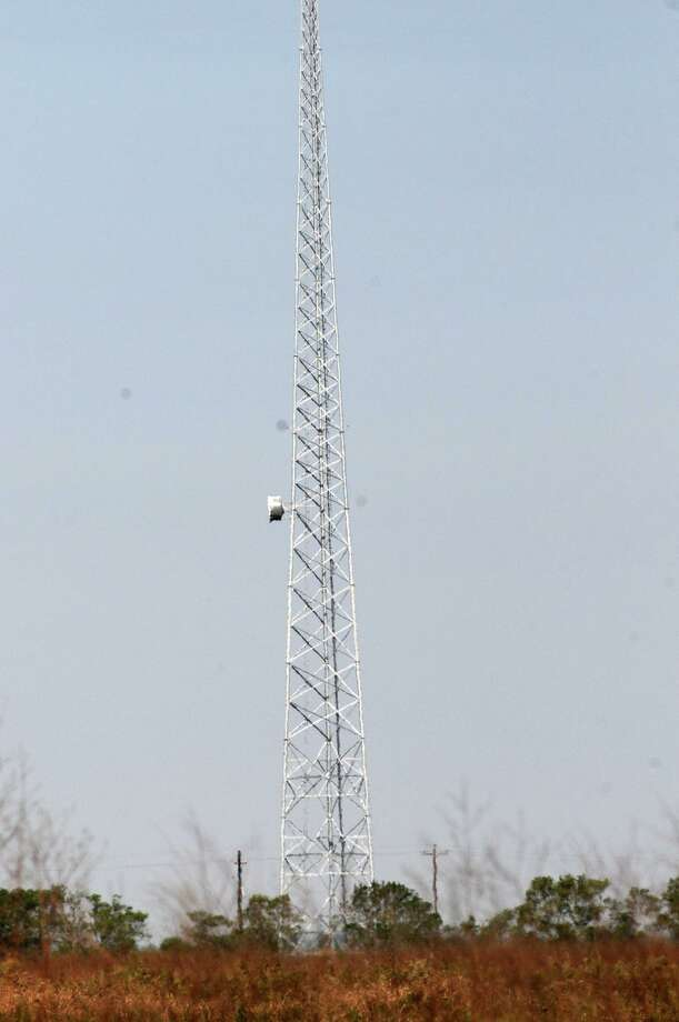 A cell tower erected on an adjoining property of the Katy Prairie Conservancy is shown in this file photo. Photo: Jerry Baker, Freelance / For The Chronicle