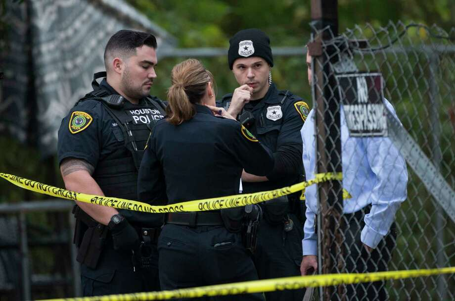 Houston Police Department homicide investigators work at a two-story house on the 6800 block of Utah Street, where two males were shot in the back of their head, on Friday, Nov. 8, 2019, in Houston. The shooting happened on the first floor. One victim died at the scene and another person was rushed to the hospital. Photo: Yi-Chin Lee, Staff Photographer / © 2019 Houston Chronicle
