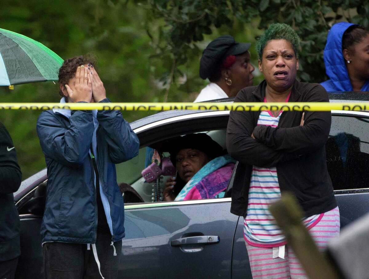 Friends and family gather react to hearing the news of two males were shot in the back of their heads inside the two-story house on the 6800 block of Utah Street early Friday morning, Nov. 8, 2019, in Houston. The shooting happened on the first floor of the house. One victim died at the scene and another person was rushed to the hospital.