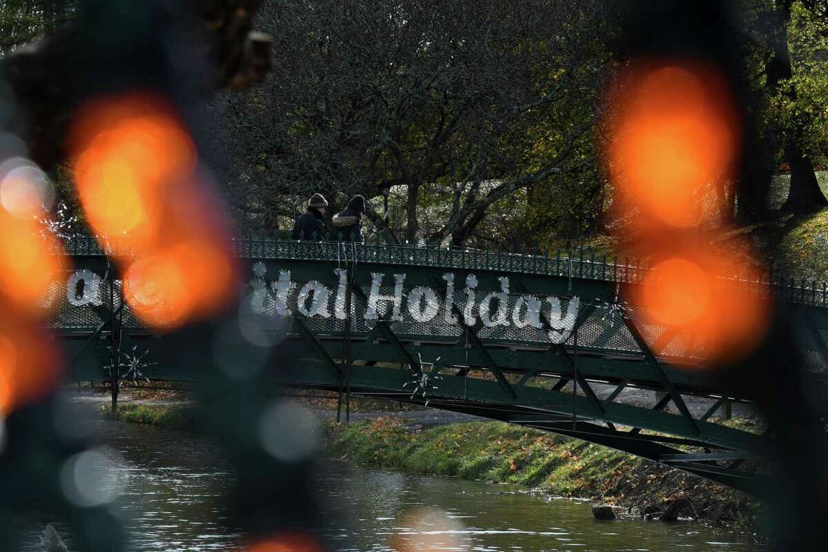 Displays and scenes from this year's Capital Holiday Lights in the Park add some extra flare for people walking through Washington Park on Friday Nov. 8, 2019, in Albany, N.Y. (Will Waldron/Times Union)