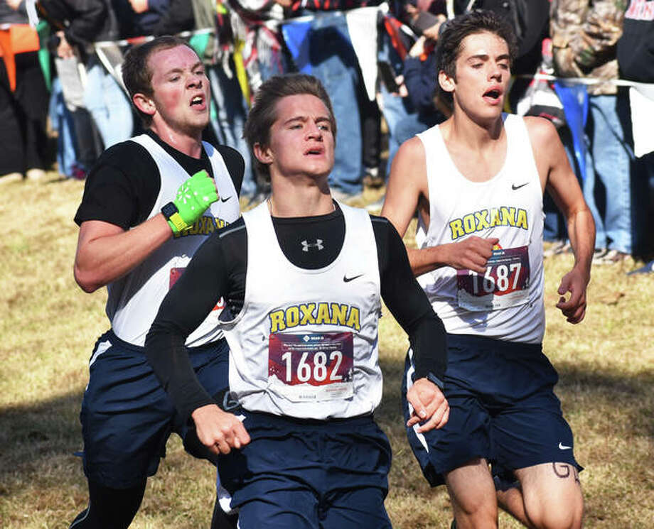 Roxana's Matthew Olbert (1682), Douglas Johnson and Austin Walker (1687) run to the finish to place 55th, 56th and 57th, respectively, in last Saturday's Class 1A boys cross country sectional at Benton.