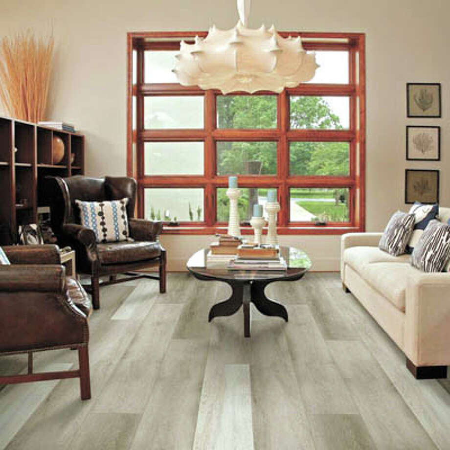Get the deep, rich aura of wood in every room? Looks like it! With Floorté vinyl plank flooring from Shaw, at Southwest Floors, 1113 Andrews Highway in Midland. Photo: Courtesy